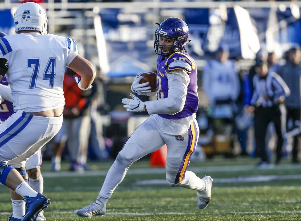 UAlbany senior defensive end Eli Mencer (#12) returns an interception as the Great Danes defeat Central Connecticut State 42-14 in the NCAA playoff at UAlbany's Casey Stadium on Nov. 30, 2019 in Albany, N.Y. (Bruce Dudek/Special to the Times Union)