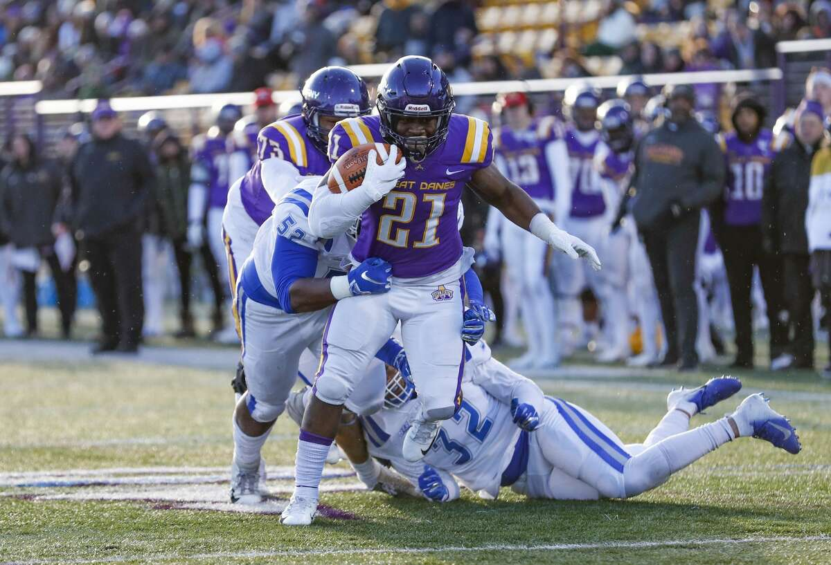 UAlbany's Karl Mofor (#21) scores a fourth quarter touchdown as the University at Albany defeats Central Connectucut State 42-14 at UAlbany's Casey Stadium, Nov, 30, 2019 in Albany, N.Y. (Bruce Dudek/Special to the Times Union)