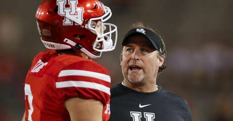 Houston Cougars head coach Dana Holgorsen talks to quarterback Clayton Tune (3) after an interception during the fourth quarter of an NCAA game against the Navy Midshipmen at TDECU Stadium Saturday, Nov. 30, 2019, in Houston. Navy won 56-41.