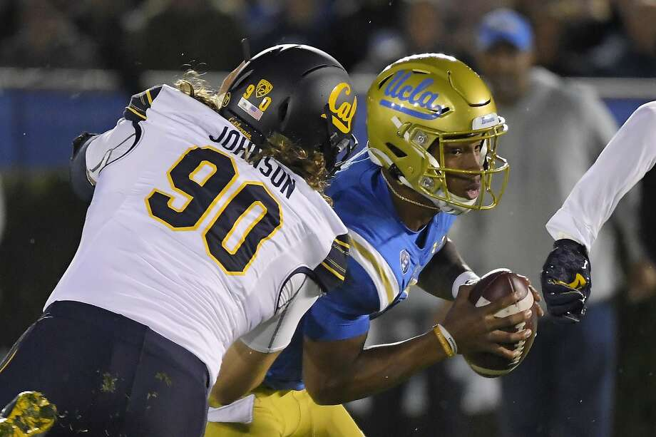 California nose tackle Brett Johnson, left, sacks UCLA quarterback Dorian Thompson-Robinson during the first half of an NCAA college football game Saturday, Nov. 30, 2019, in Pasadena, Calif. (AP Photo/Mark J. Terrill) Photo: Mark J. Terrill, Associated Press