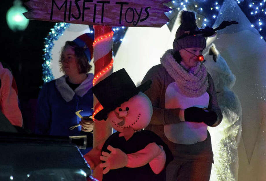 "Workers from Heritage Health dress up as characters from the Island of Misfit Toys from the movie ""Rudolph the Red-Nosed Reindeer"" Saturday during the Beardstown Christmas Parade. Photo: Samantha McDaniel-Ogletree 