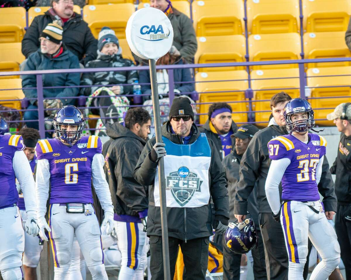 UAlbany men's lacrosse coach Scott Marr volunteered for the chain gang during the Great Danes football playoff game against Central Connecticut at Casey Stadium on Nov. 30, 2019. (Jim Franco/Special to the Times Union)