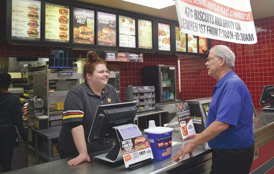 Hardee's manager Dennis Hayes (right) talks Friday to employee Desah Walden. Hayes is celebrating his 47th anniversary of working for the restaurant today. Photo: Marco Cartolano | Journal-Courier