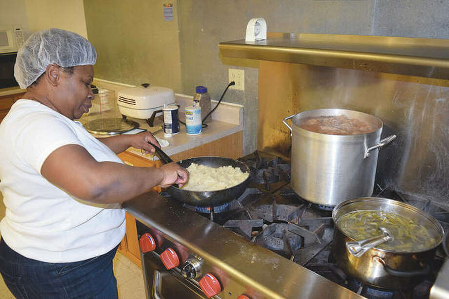 Spirit of Faith Soup Kitchen director Polly Pulley prepares a meal in 2017. Photo: Journal-Courier