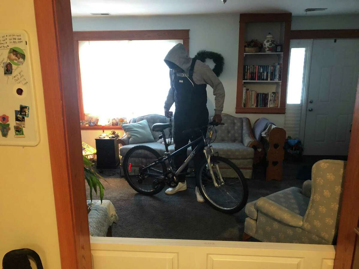 Jesse Caparratto stores his bike in his living room. His mother wishes he'd keep it elsewhere, but he worries that someone in the neighborhood might steal it if he leaves it outside.