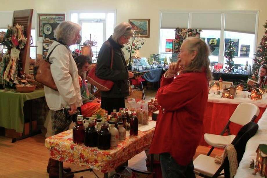 The Portage Lake Holiday Art Fair had all kinds of items up for sale on Saturday, including homemade maple syrup products. The fair is always held the Saturday after Thanksgiving each year. (Ken Grabowski/News Advocate)