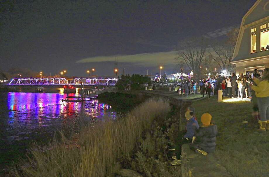 The crowd watches the lights turn on on the historic Cribari Bridge at the Saugatuck Bridge Lighting Holiday Festival at the Saugatuck Rowing Club on Nov. 29, 2019, in Westport. Photo: Jarret Liotta / For Hearst Connecticut Media / Jarret Liotta / ©Jarret Liotta