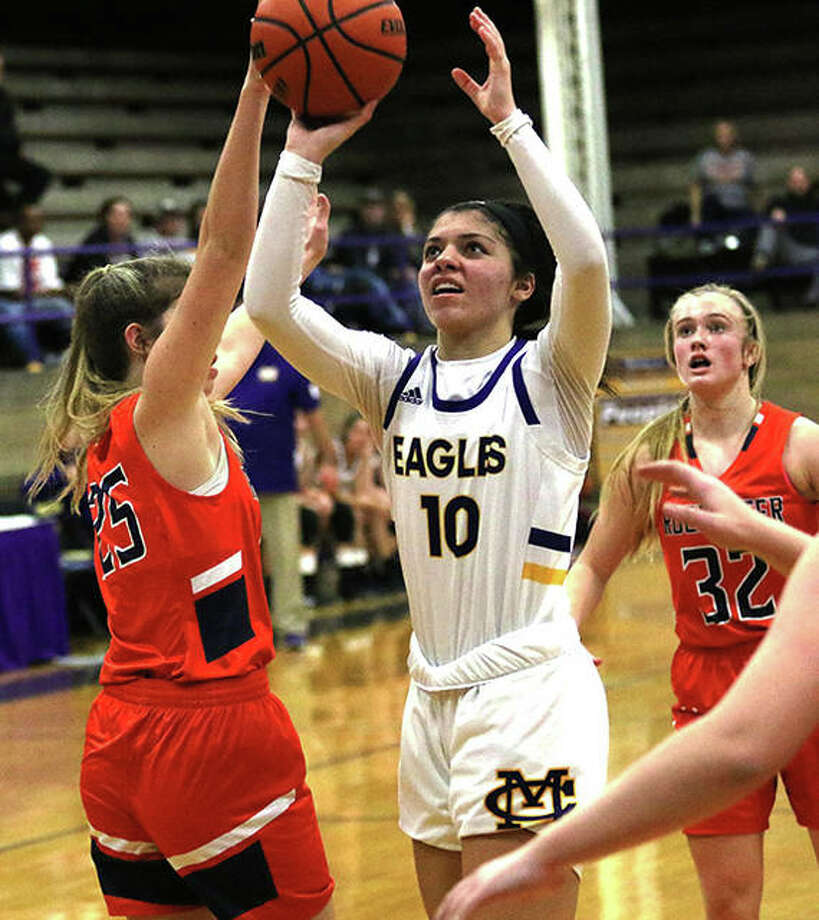CM's Kourtland Tyus (10) scores in the lane after penetrating Rochester's defense in the first half Saturday night at the Taylorville Thanksgiving Tournament. Photo: Greg Shashack / The Telegraph