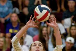 Alyssa May (8) of Magnolia West was selected as the District 19-5A Most Valuable Setter.
