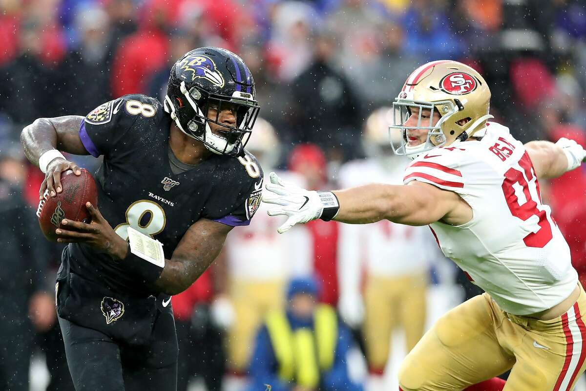 BALTIMORE, MARYLAND - DECEMBER 01: Quarterback Lamar Jackson #8 of the Baltimore Ravens scrambles in front of Nick Bosa #97 of the San Francisco 49ers in the first half at M&T Bank Stadium on December 01, 2019 in Baltimore, Maryland. (Photo by Rob Carr/Getty Images)