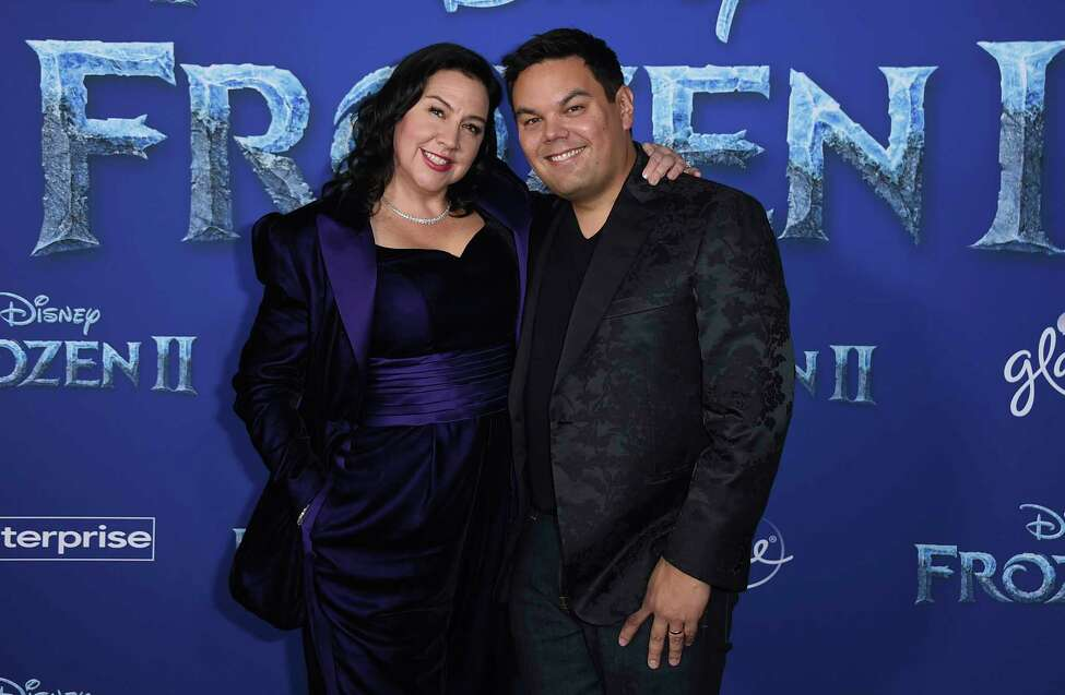 Songwriters Kristen Anderson-Lopez, left, and Robert Lopez arrive at the world premiere of