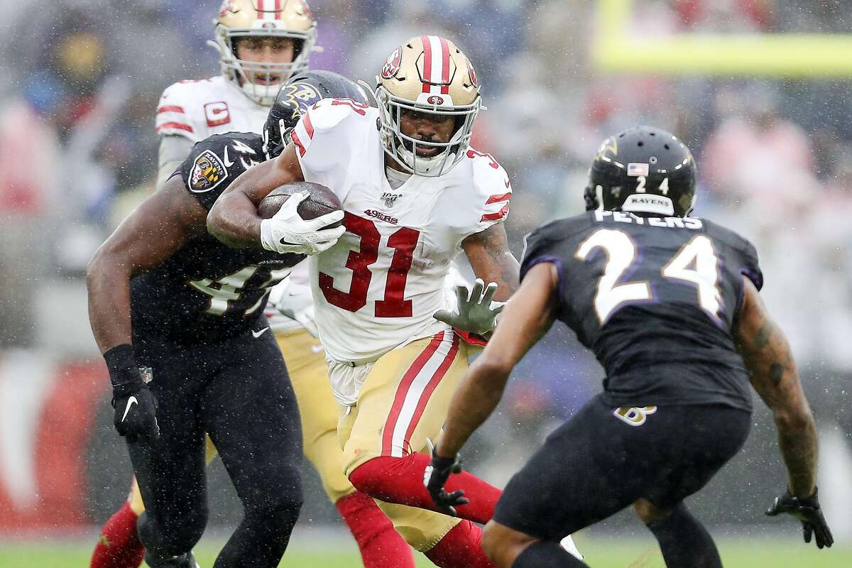 BALTIMORE, MARYLAND - DECEMBER 01: Raheem Mostert #31 of the San Francisco 49ers runs with the ball during the first half against the Baltimore Ravens at M&T Bank Stadium on December 01, 2019 in Baltimore, Maryland. (Photo by Patrick Smith/Getty Images)