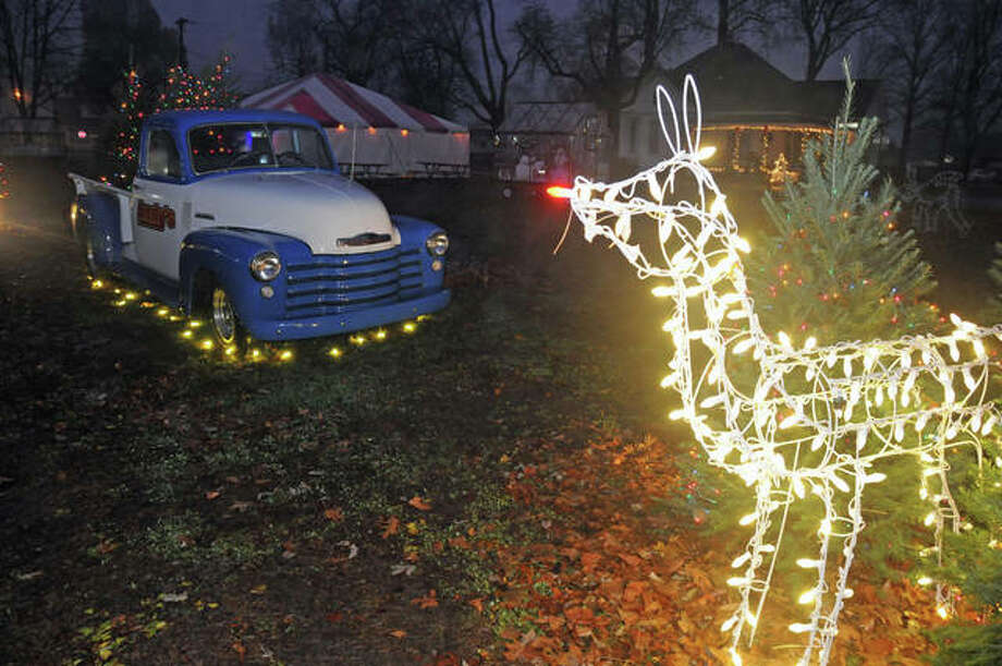 An illuminated reindeer display lights the way at Saturday's opening night of the Bethalto Christmas Village. Photo: David Blanchette|For The Telegraph
