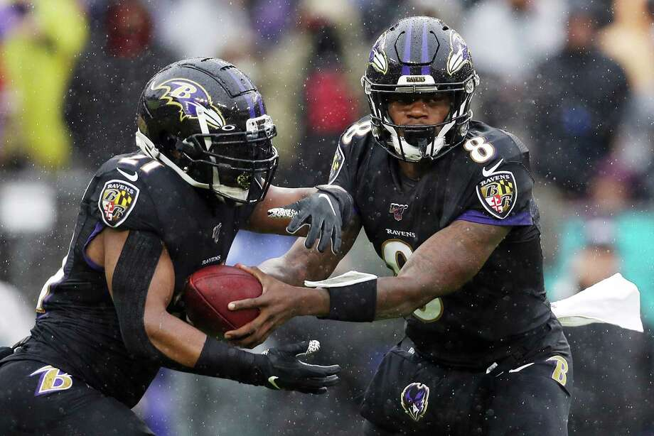 BALTIMORE, MARYLAND - DECEMBER 01: Lamar Jackson #8 looks to hand off the ball to Mark Ingram II #21 of the Baltimore Ravens during the first half against the San Francisco 49ers at M&T Bank Stadium on December 01, 2019 in Baltimore, Maryland. Photo: Patrick Smith, Getty Images / 2019 Getty Images