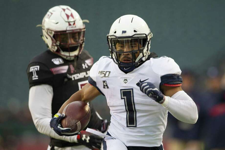 Art Thompkins of UConn runs with the ball past Chapelle Russell of the Temple Owls in the first quarter at Lincoln Financial Field on November 30, 2019 in Philadelphia. Photo: Mitchell Leff / Getty Images / 2019 Getty Images