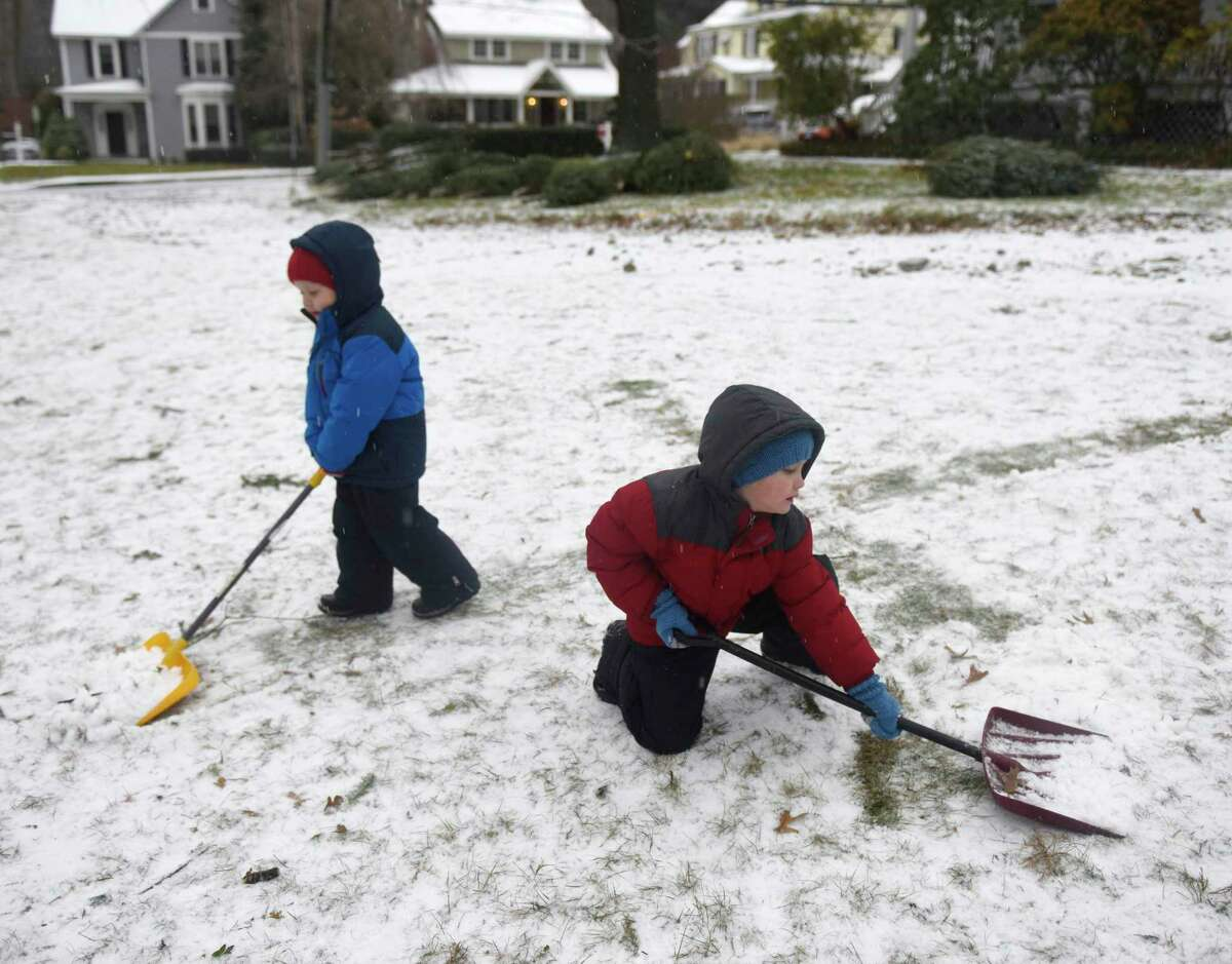 Brothers Jonah Collins, left, 3, and Micah Collins, 6, shovel snow while helping out at the Tree & Wreath Sale at First Congregational Church of Old Greenwich in Old Greenwich, Conn. Sunday, Dec. 1, 2019. FCCOG is selling top grade New Hampshire trees and wreaths with all benefits going to charities Kids in Crisis, SoundWaters, Pacific House, Building 1 Community, Mothers for Others, and The Den for Grieving Kids.