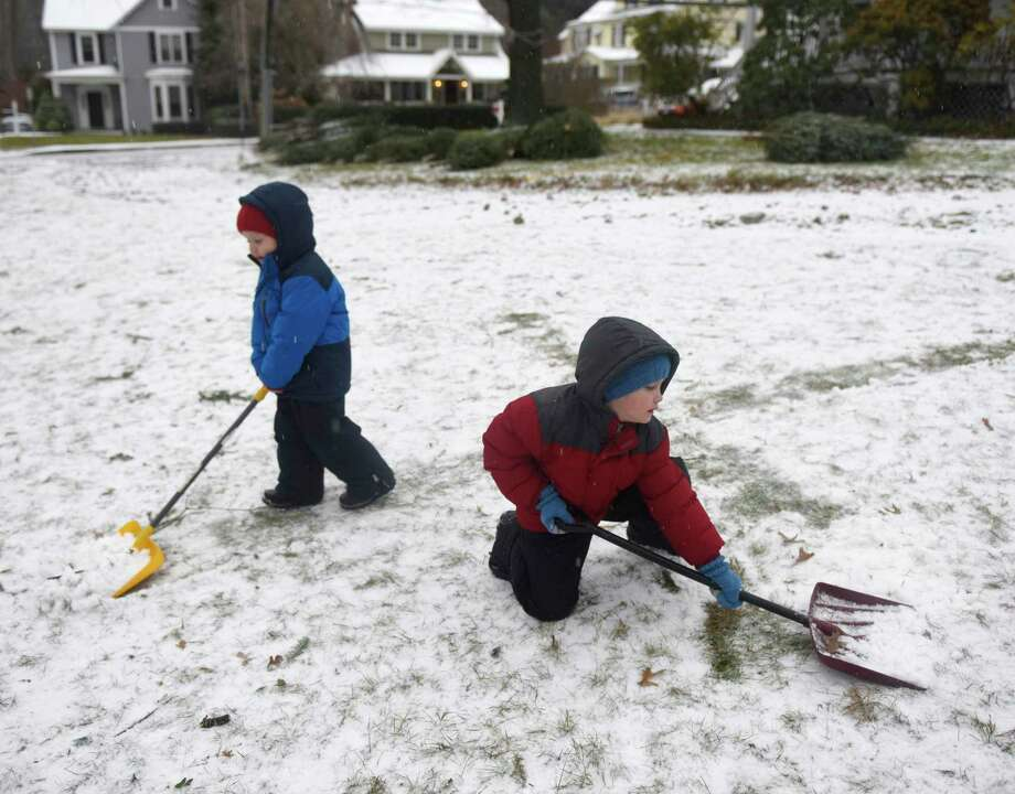 Brothers Jonah Collins, left, 3, and Micah Collins, 6, shovel snow while helping out at the Tree & Wreath Sale at First Congregational Church of Old Greenwich in Old Greenwich, Conn. Sunday, Dec. 1, 2019. FCCOG is selling top grade New Hampshire trees and wreaths with all benefits going to charities Kids in Crisis, SoundWaters, Pacific House, Building 1 Community, Mothers for Others, and The Den for Grieving Kids. Photo: Tyler Sizemore / Hearst Connecticut Media / Greenwich Time