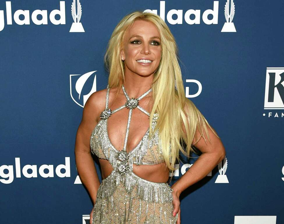 FILE - In this April 12, 2018 file photo, Britney Spears arrives at the 29th annual GLAAD Media Awards in Beverly Hills, Calif. Spears has been granted a restraining order against a former confidante who she says has been harassing her family. A judge Wednesday, May 8, 2019, ordered the man, 44-year-old Sam Lutfi, to stay at least 200 yards from Spears, her parents and her sons. (Photo by Chris Pizzello/Invision/AP, File)