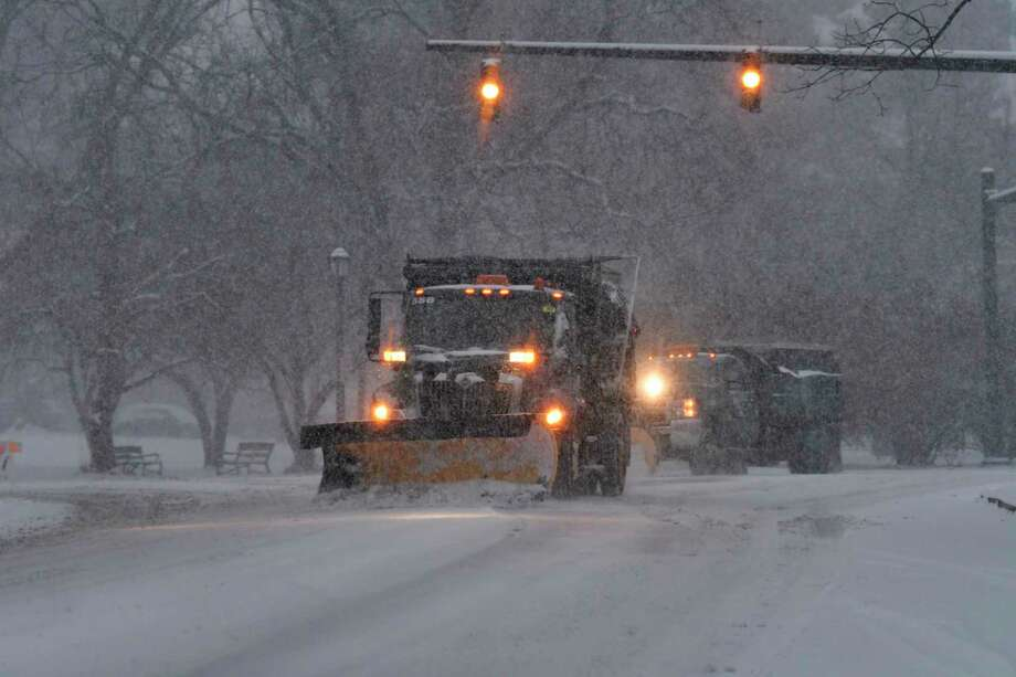 City of Albany employees drive snow plows to clear the streets on Sunday, Dec. 1, 2019, in Albany, N.Y.   (Paul Buckowski/Times Union) Photo: Paul Buckowski, Albany Times Union / (Paul Buckowski/Times Union)