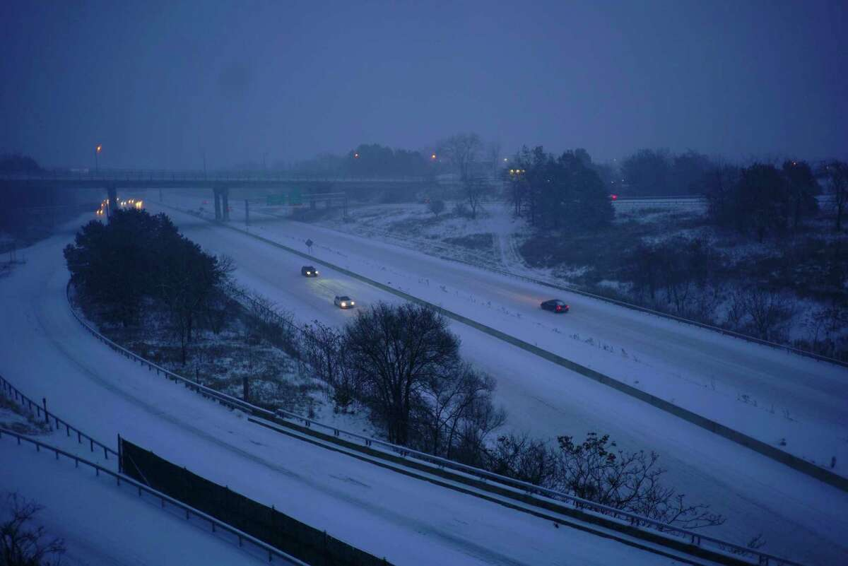 As snow falls, vehicles are driven slowly along Interstate 90 on Sunday, Dec. 1, 2019, in Albany, N.Y. (Paul Buckowski/Times Union)