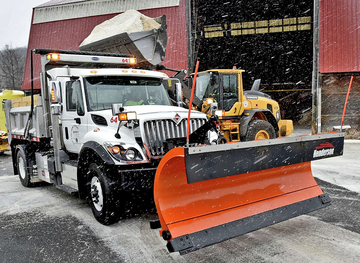 New Haven, Connecticut - Sunday, December, 1, 2019: A New Haven Department of Public Works pay loader dumps salt into its snowplow trucks Sunday afternoon as the City of New Haven prepares to attack the snowstorm with its snow removal teams.