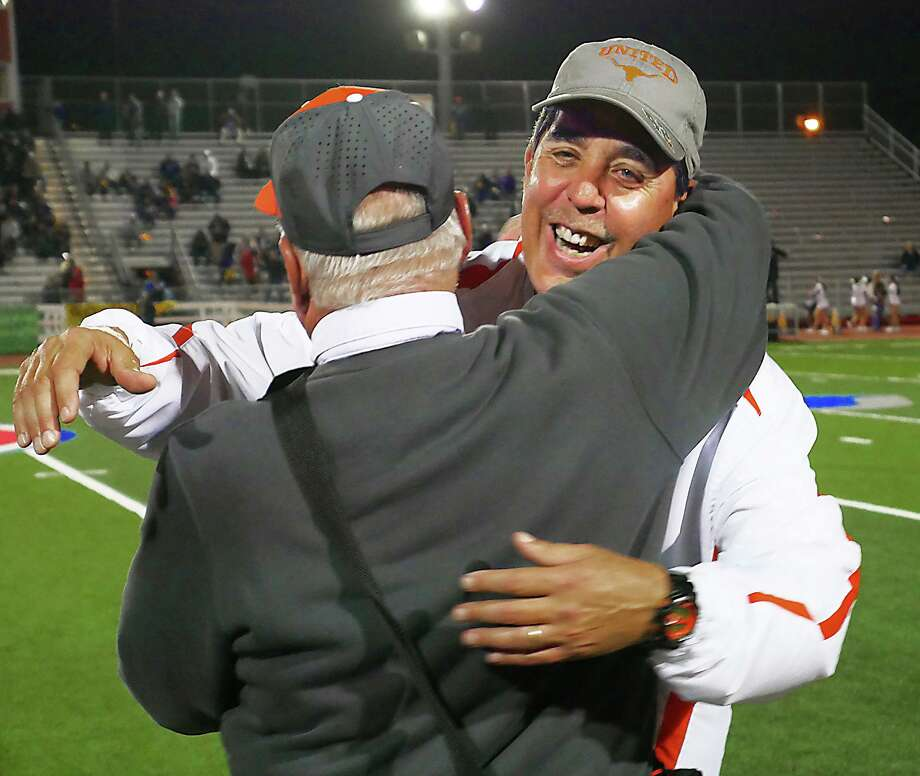 United High School head football coach, David Sanchez celebrates with his team and coaches after their win against San Benito, Friday, November 22, 2019 in Rio Grande City, Texas. Photo: Cuate Santos / Laredo Morning Times / Laredo Morning Times