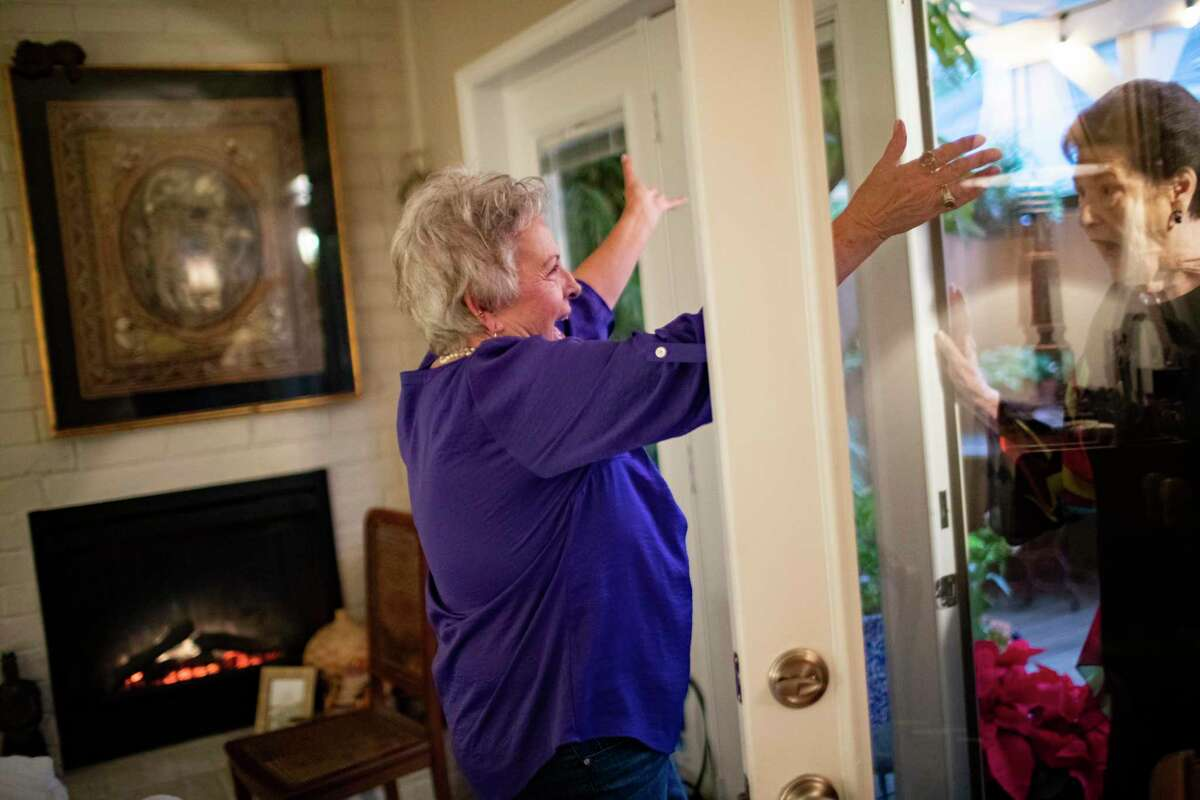 Teresa Powell welcomes her friend Kathy Moore to her home on Friday, Nov. 22, 2019, in Houston.
