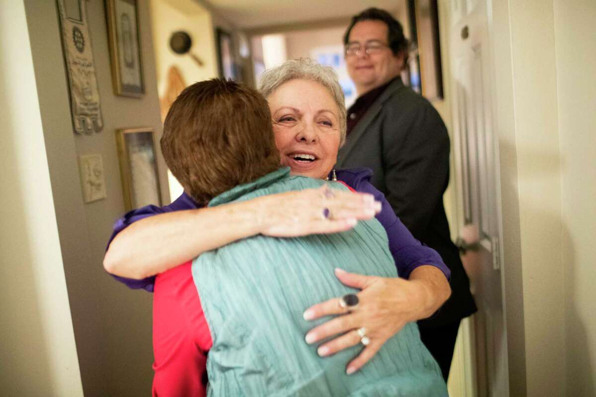Teresa Powell welcomes her friend Lida Dahm with an embrace to her home on Friday, Nov. 22, 2019, in Houston.