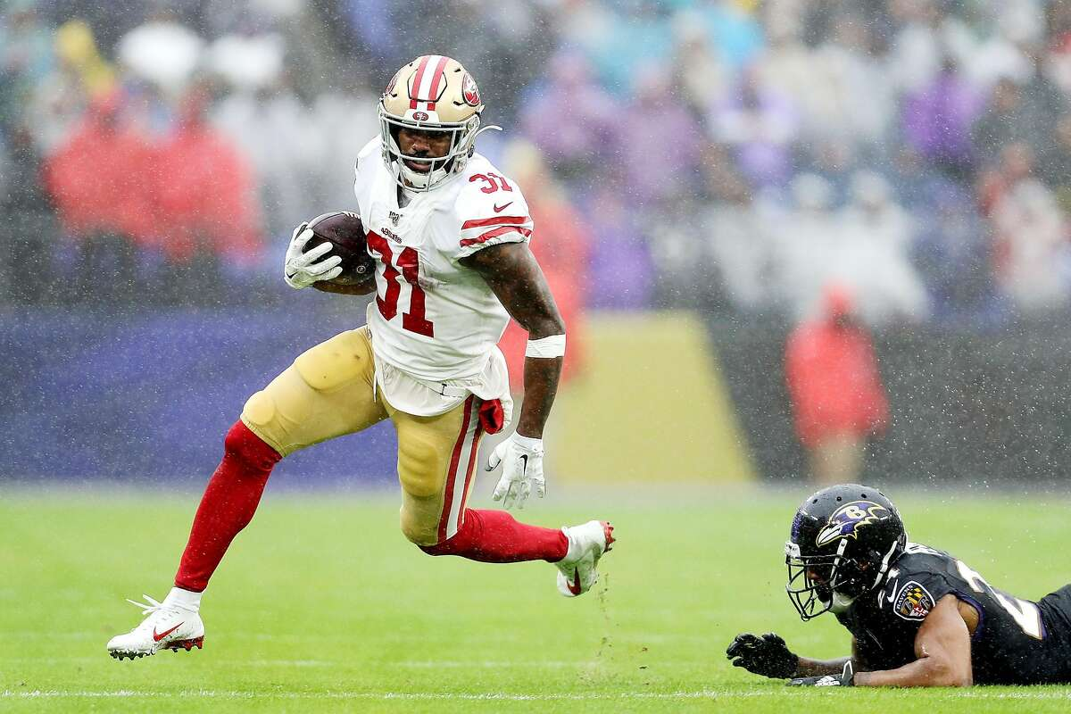 BALTIMORE, MARYLAND - DECEMBER 01: Raheem Mostert #31 of the San Francisco 49ers rushes for a 40-yard touchdown during the second quarter as Marcus Peters #24 of the Baltimore Ravens is unable to make the tackle at M&T Bank Stadium on December 01, 2019 in Baltimore, Maryland. (Photo by Patrick Smith/Getty Images)