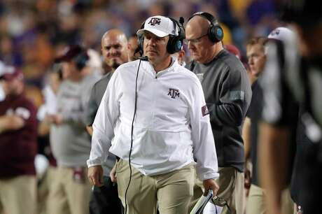 Texas A&M coach Jimbo Fisher walks along the sideline during the first half of the team's game against LSU in Baton Rouge, La., on Nov. 30, 2019.