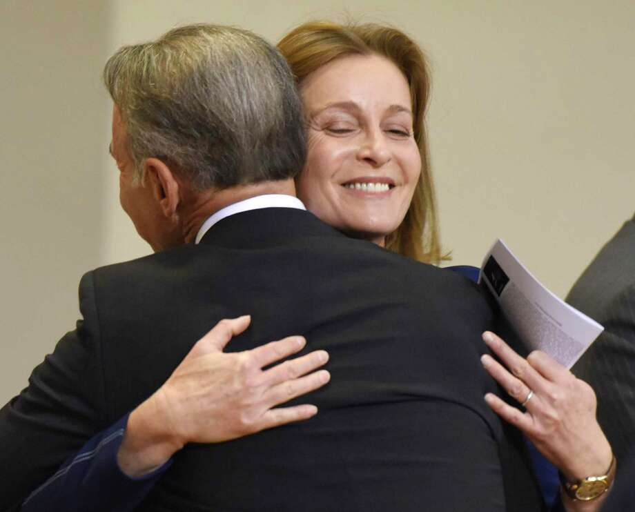 Selectwoman Jill Oberlander gives a hug to First Selectman Fred Camillo after being sworn in at the Board of Selectmen swearing-in ceremony at the Boys & Girls Club of Greenwich in Greenwich, Conn. Sunday, Dec. 1, 2019. Republican Fred Camillo was sworn in as First Selectman, while fellow Republican Lauren Rabin and Democrat Jill Oberlander were sworn in as Selectwomen. Photo: Tyler Sizemore / Hearst Connecticut Media / Greenwich Time