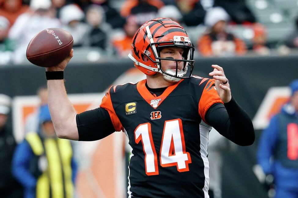 Cincinnati Bengals quarterback Andy Dalton looks to pass during the first half of an NFL football game against the New York Jets, Sunday, Dec. 1, 2019, in Cincinnati. (AP Photo/Frank Victores)