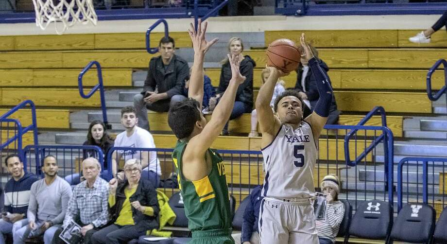 Yale's Azar Swain takes a jump shot against Vermont Sunday. Photo: Steve Musco / Contributed Photo Via Yale Athletics / © Steve Musco 2019-2020, all rights reserved