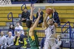 Yale's Azar Swain takes a jump shot against Vermont Sunday.