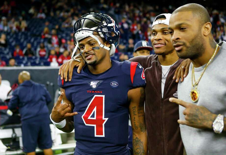 PHOTOS: Other Texans fans on the field before Sunday's game against the Patriots Houston Texans quarterback Deshaun Watson (4) takes a picture with Rockets players Russell Westbrook and P.J. Tucker before the first quarter of an NFL football game at NRG Stadium on Sunday, Dec. 1, 2019, in Houston. Photo: Brett Coomer, Staff Photographer / © 2019 Houston Chronicle