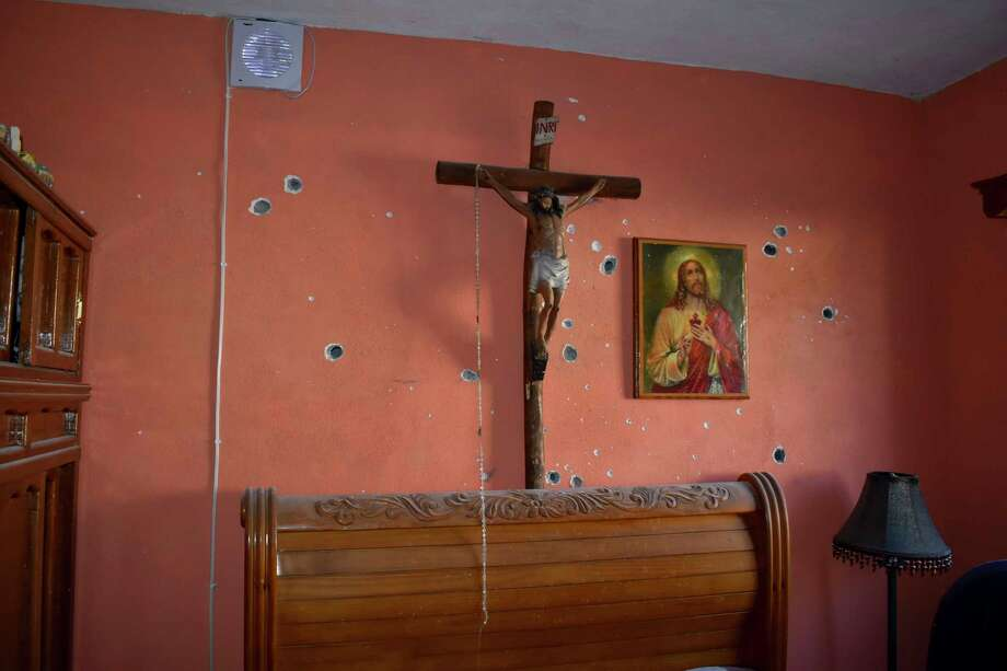 Bullet holes riddle the interior of a home after a gun battle between Mexican security forces and suspected cartel members, in Villa Union, Mexico, Saturday, Nov. 30, 2019. At least 14 people were killed, four of them police officers, after an armed group in a convoy of trucks stormed the town, in Coahuila state, prompting security forces to intervene, state Gov. Miguel Riquelme Solis said. (AP Photo/Gerardo Sanchez) Photo: Gerardo Sanchez / Copyright 2019 The Associated Press. All rights reserved.