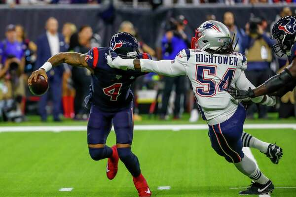 Houston Texans quarterback Deshaun Watson (4) evades New England Patriots outside linebacker Dont'a Hightower (54) and ends up throwing the ball away during the first quarter of an NFL football game at NRG Stadium on Sunday, Dec. 1, 2019, in Houston.