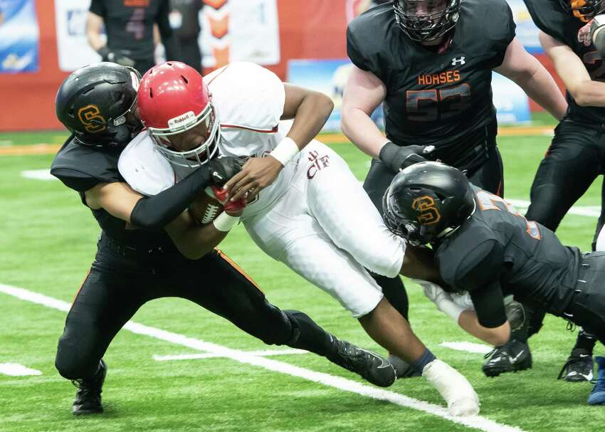 Schuylerville defensive back Charles Luzadis, right, and Caleb Max, left, tackle Chenango Forks running back Dubbs Haqq during the Class B State Championship on Sunday, Dec. 1, 2019, at the Carrier Dome in Syracuse, N.Y. (Jenn March, Special to the Times Union)