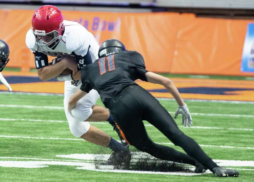 Schuylerville defensive back Ryan Dow tackles Chenango Forks quarterback Ray Austin during the Class B State Championship on Sunday, Dec. 1, 2019, at the Carrier Dome in Syracuse, N.Y. (Jenn March, Special to the Times Union)
