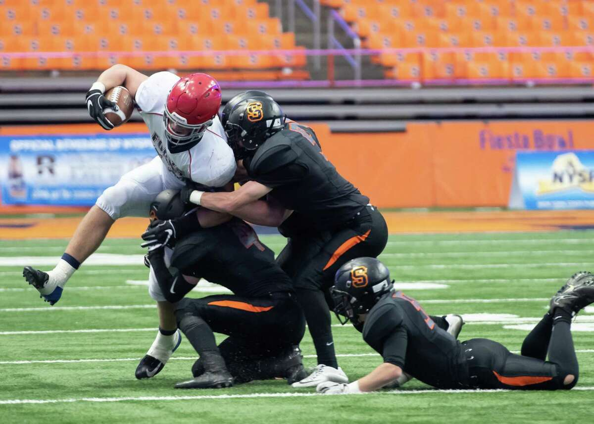 Schuylerville defense takes down Chenango Forks running back Lucas Scott during the Class B State Championship on Sunday, Dec. 1, 2019, at the Carrier Dome in Syracuse, N.Y. (Jenn March, Special to the Times Union)
