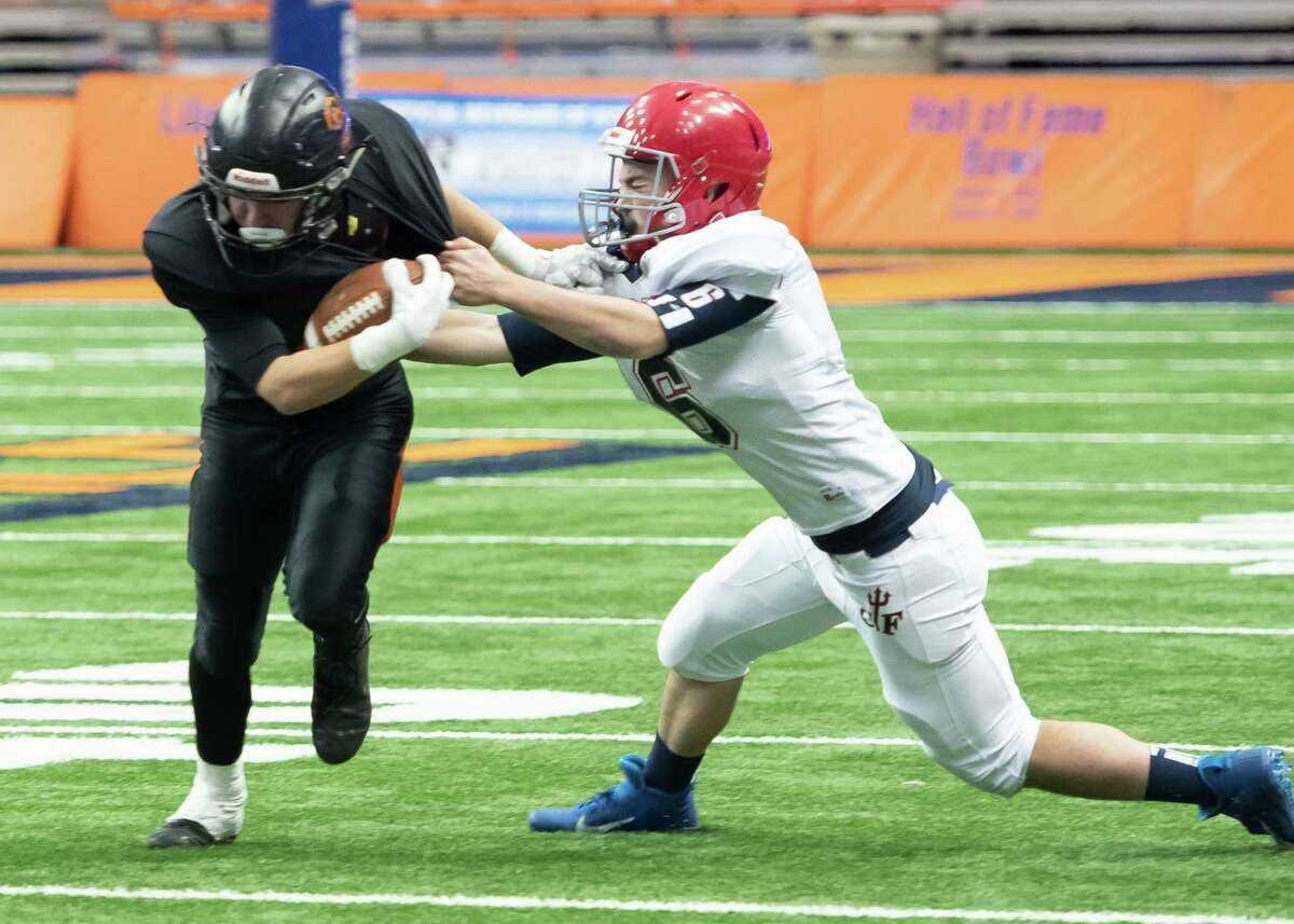 Chenango Forks defensive back Jack Zimmerman grabs hold of Schuylerville running back Charles Luzadis during the Class B State Championship on Sunday, Dec. 1, 2019, at the Carrier Dome in Syracuse, N.Y. (Jenn March, Special to the Times Union)