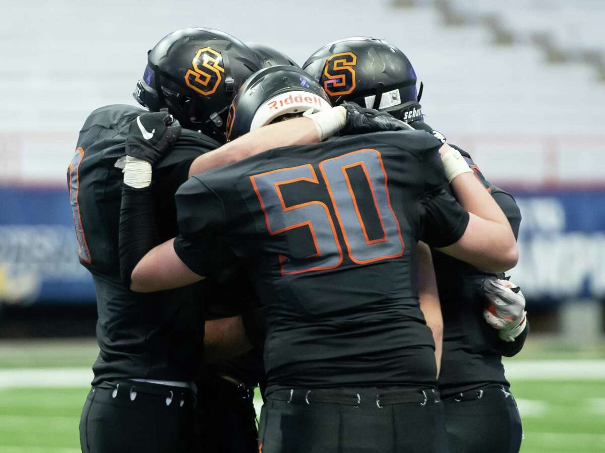 Schuylerville football players comfort each other following their loss to Chenango Forks in the Class B State Championship on Sunday, Dec. 1, 2019, at the Carrier Dome in Syracuse, N.Y. (Jenn March, Special to the Times Union)