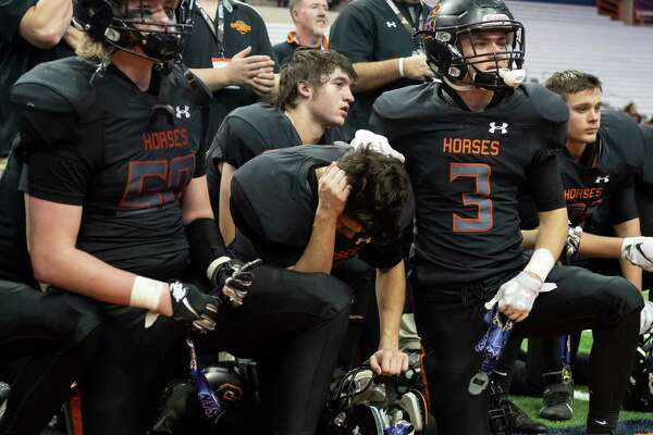 Schuylerville's Charles Luzadis (3) comforts Conner Bilinski, center, following their team's loss to Chenango Forks in the Class B State Championship on Sunday, Dec. 1, 2019, at the Carrier Dome in Syracuse, N.Y. (Jenn March, Special to the Times Union)