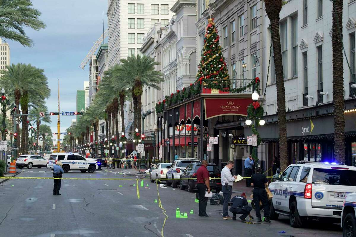New Orleans police investigate the scene of a shooting Sunday, Dec. 1, 2019, on the edge of the city's famed French Quarter. (Max Becherer/The Times-Picayune/The New Orleans Advocate via AP)