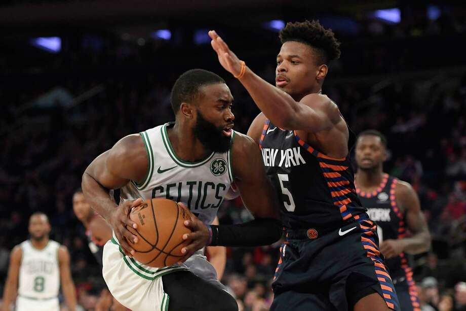 New York Knicks guard Dennis Smith Jr. (5) defends against Boston Celtics guard Jaylen Brown during the second half of an NBA basketball game, Sunday, Dec. 1, 2019, in New York. (AP Photo/Sarah Stier) Photo: Sarah Stier / Copyright 2019 The Associated Press. All rights reserved.