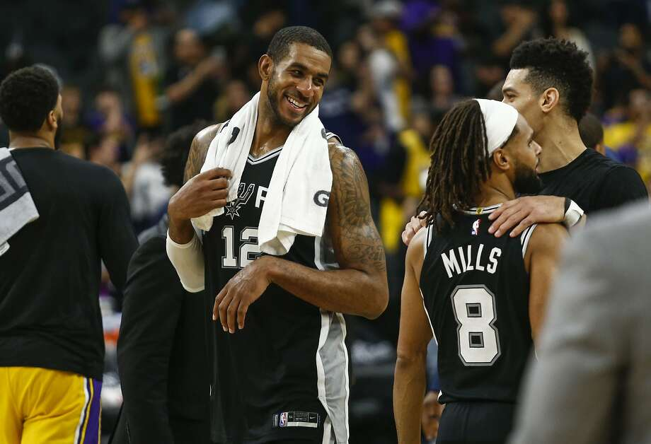 San Antonio Spurs' LaMarcus Aldridge smiles at teammates  after the Spurs' game against the Lakers at AT&T Center in San Antonio, Texas on Nov. 25, 2019. Photo: Josie Norris, Staff Photographer