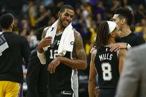 San Antonio Spurs' LaMarcus Aldridge smiles at teammates  after the Spurs' game against the Lakers at AT&T Center in San Antonio, Texas on Nov. 25, 2019.