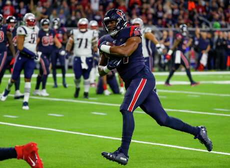 Houston Texans tight end Darren Fells (87) runs for a touchdown on a 13-yard pass from Houston Texans quarterback Deshaun Watson (4) during the second quarter of an NFL football game at NRG Stadium on Sunday, Dec. 1, 2019, in Houston.