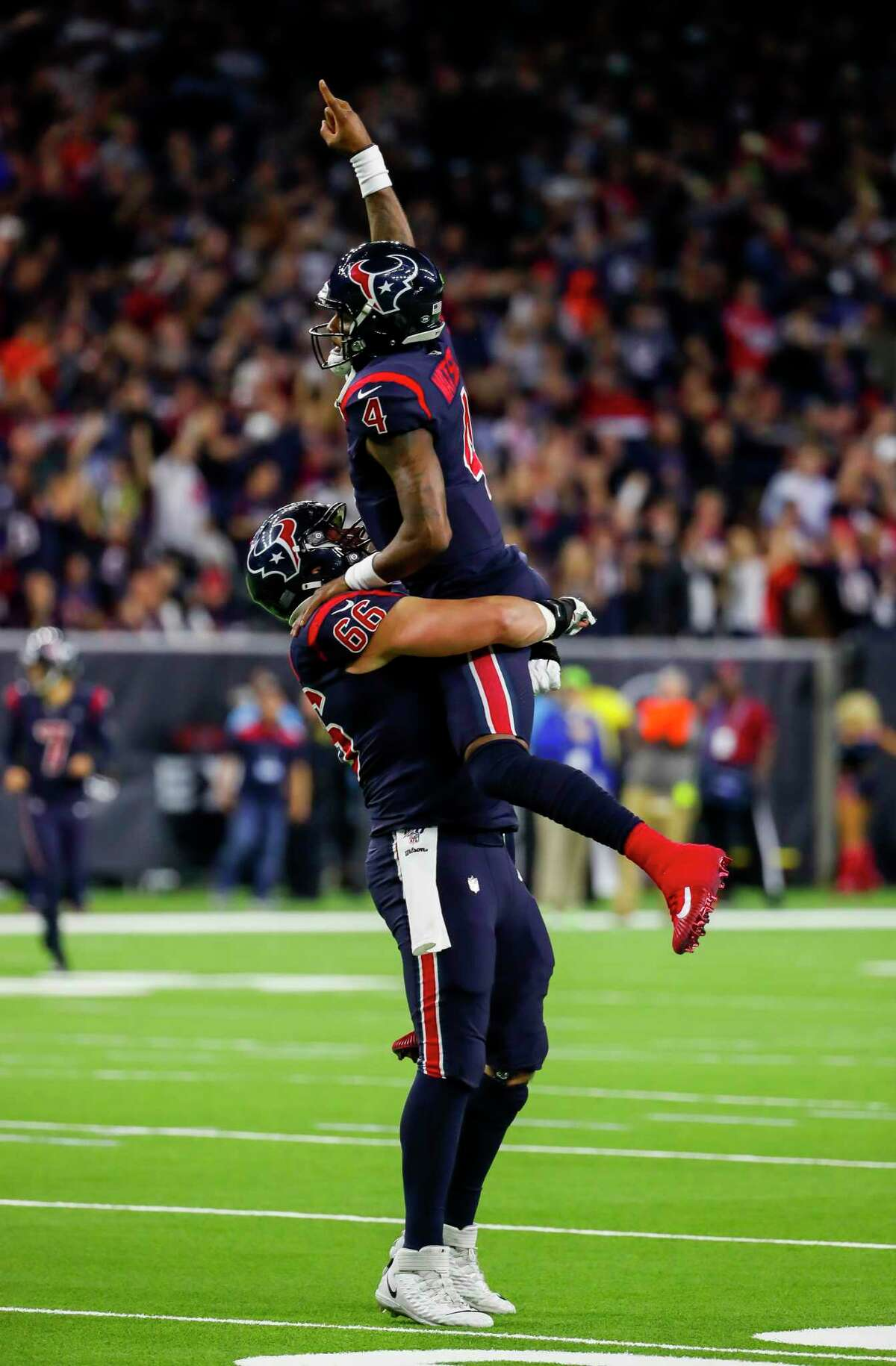 Houston Texans quarterback Deshaun Watson (4) and Houston Texans center Nick Martin (66) celebrate after Watson threw a 13-yard touchdown pass to Houston Texans tight end Darren Fells (87) during the second quarter of an NFL football game at NRG Stadium on Sunday, Dec. 1, 2019, in Houston.