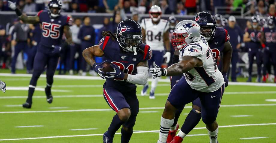 Houston Texans cornerback Bradley Roby (21) runs back a 22-yard interception during the first quarter of an NFL football game at NRG Stadium on Sunday, Dec. 1, 2019, in Houston. Photo: Brett Coomer/Staff Photographer